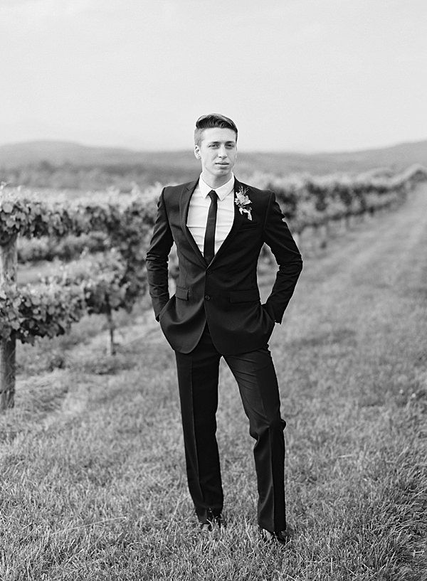 classic black and white groom portrait