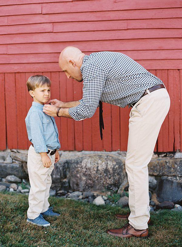 groom fixing son's tie