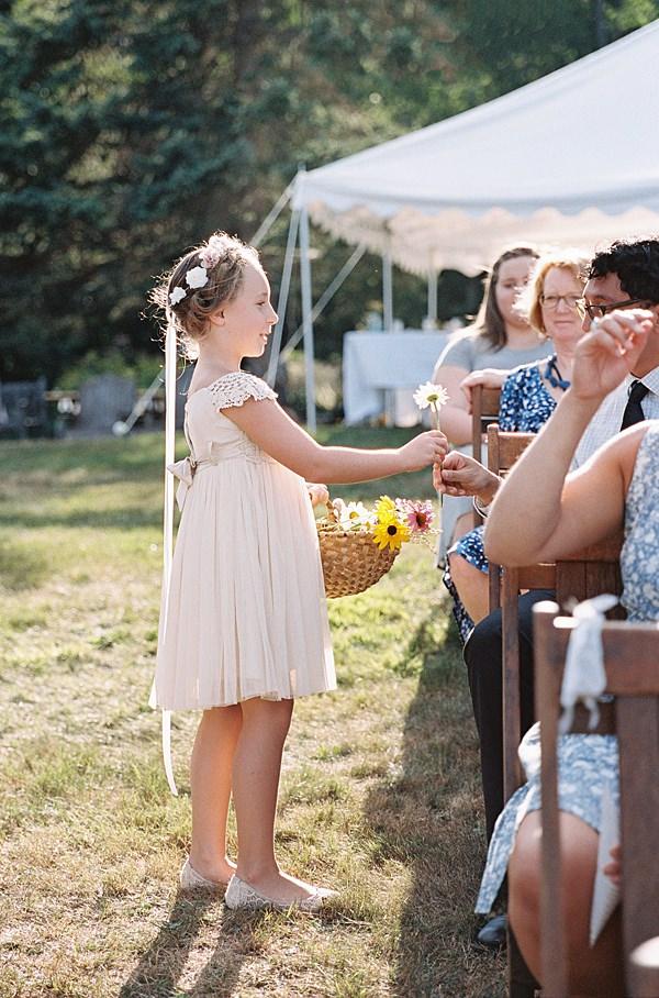 flower girl handing out flowers