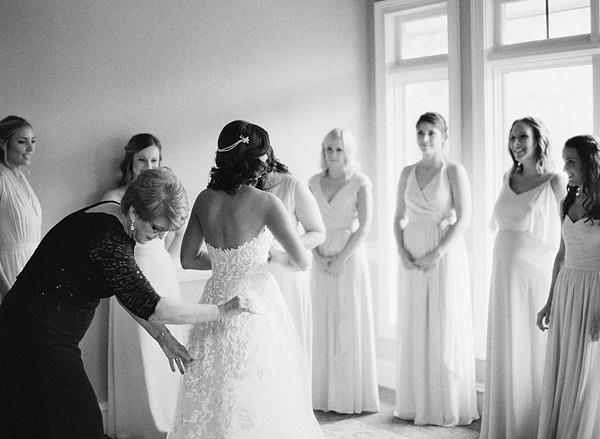 bride's mom zipping dress