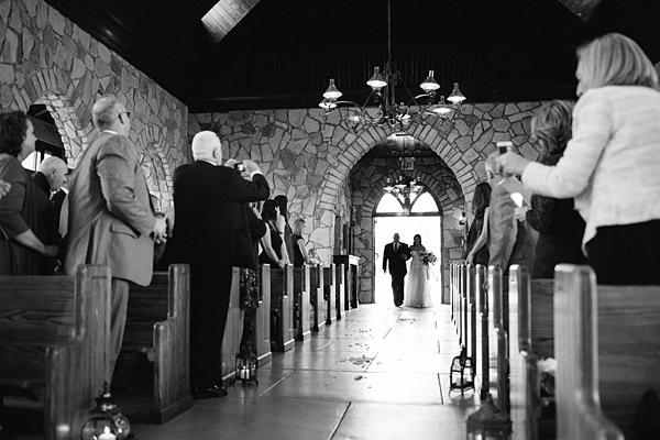 bride walking in chapel doors