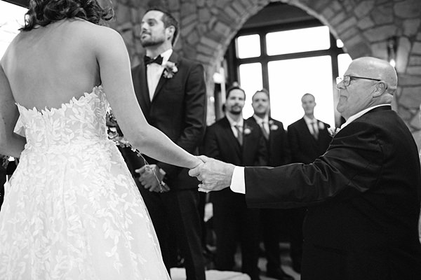 bride and father holding hands