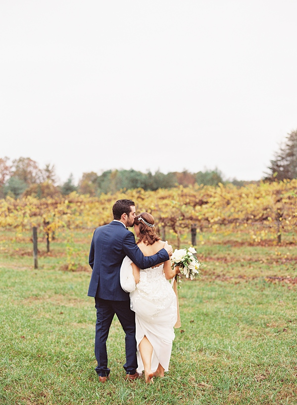 bride and groom walking barefoot