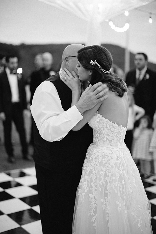 emotional bride and father