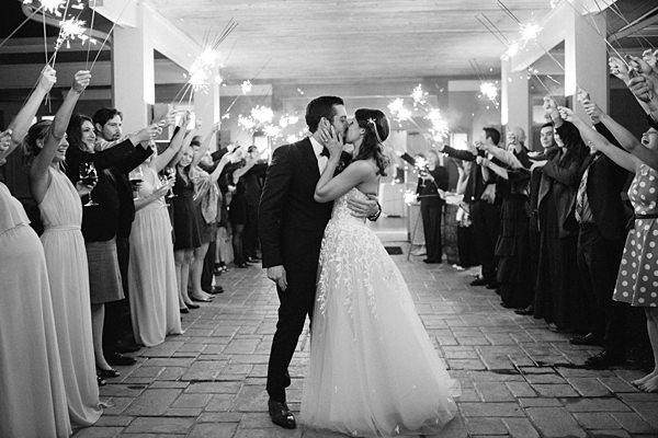 romantic wedding exit kiss
