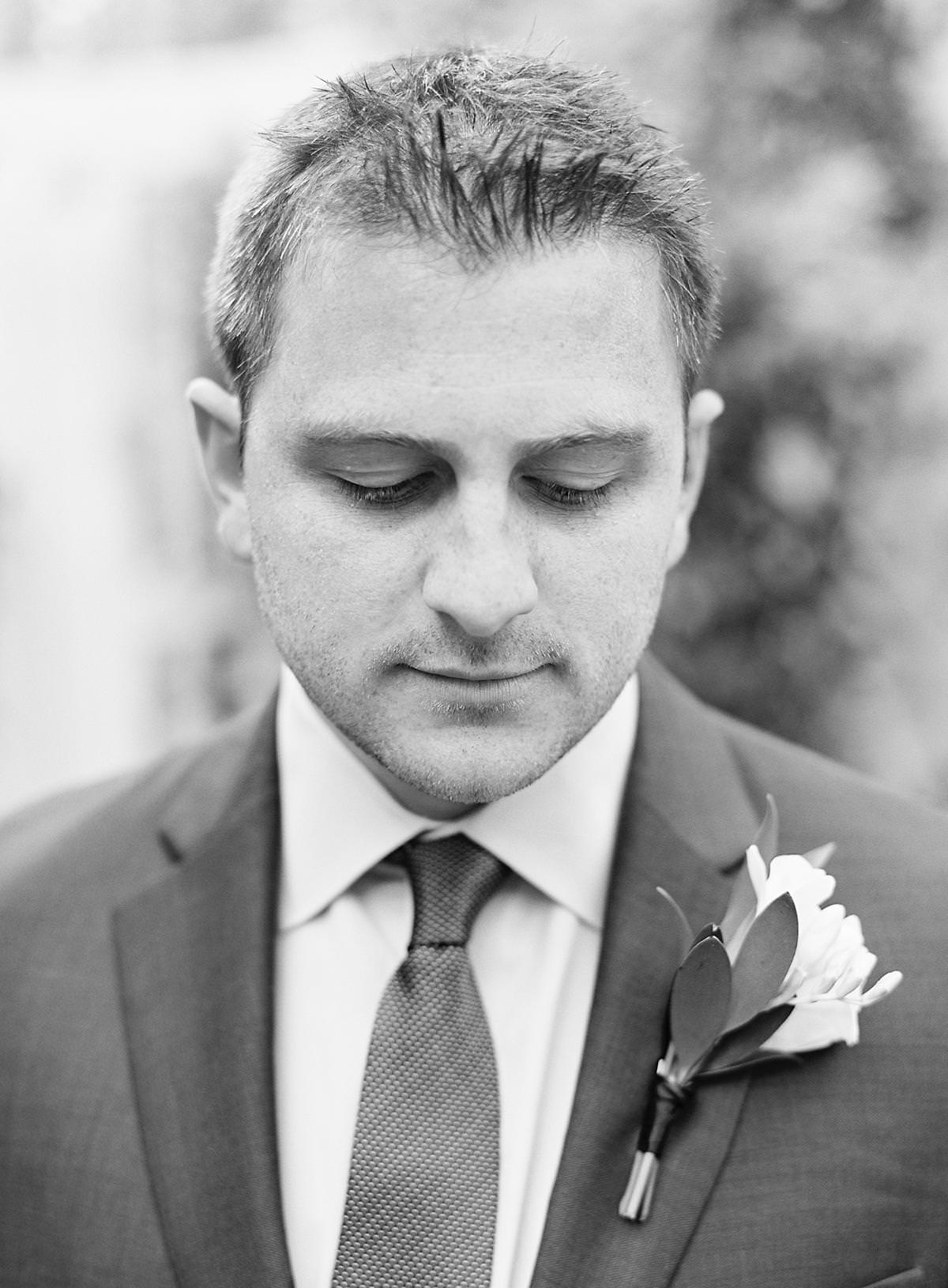 groom on black and white film