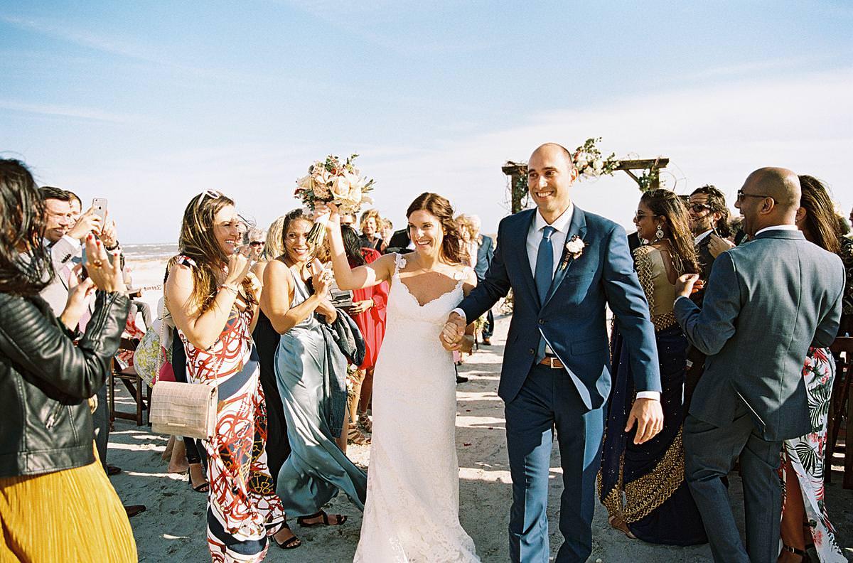 bride and groom beach ceremony exit