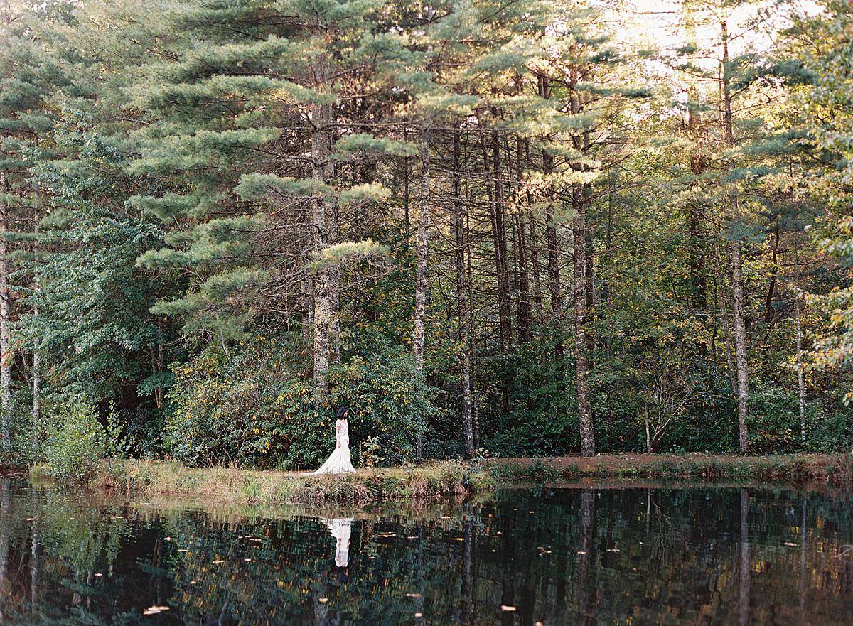 bride walking along pond
