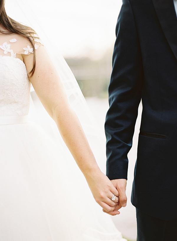 bride-groom-holding-hands