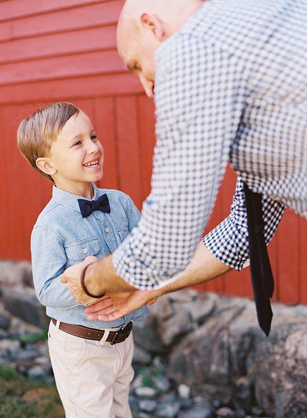 groom helping son get dressed