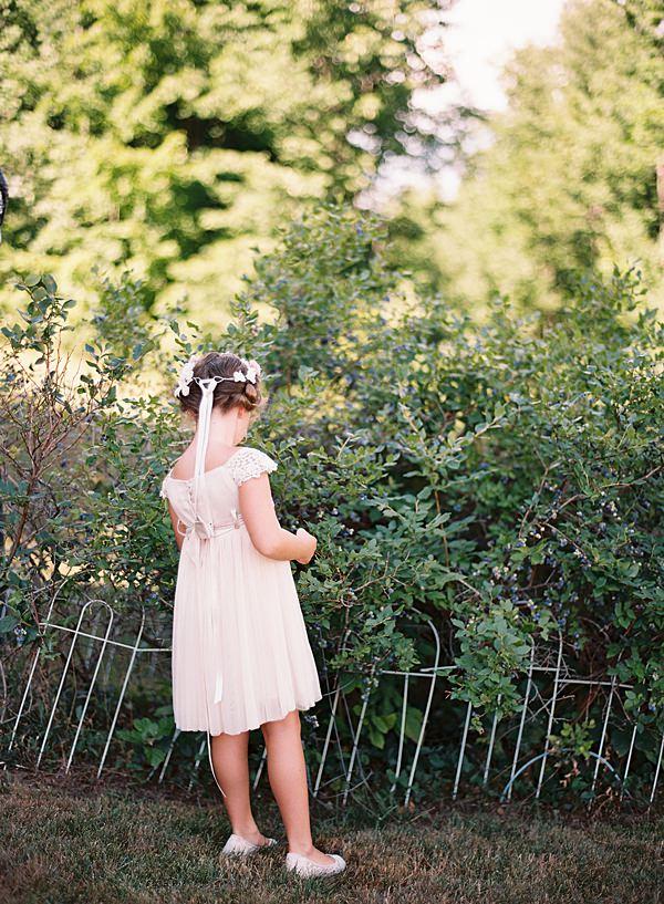 flower girl picking blueberries
