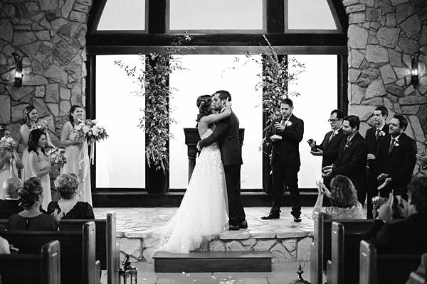 black and white wedding kiss
