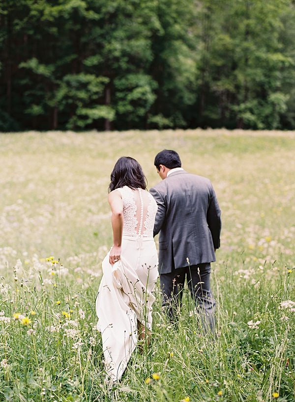 bride and groom in switzerland field