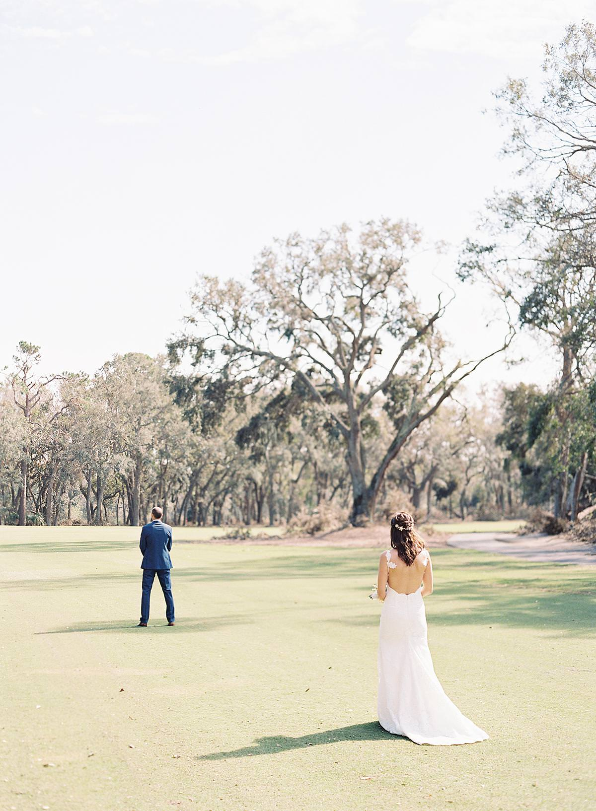 hilton head bride walking to groom