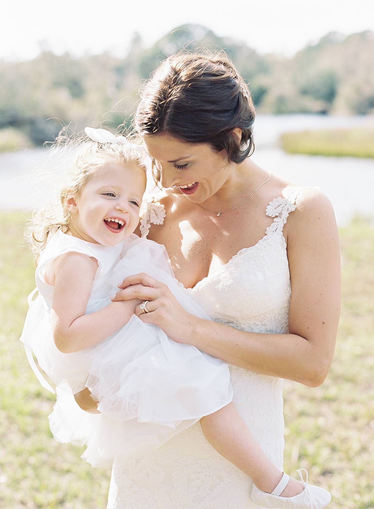 bride holding flower girl