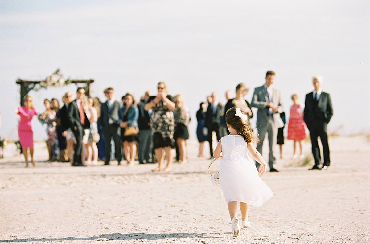 flower girl on windy day at beach