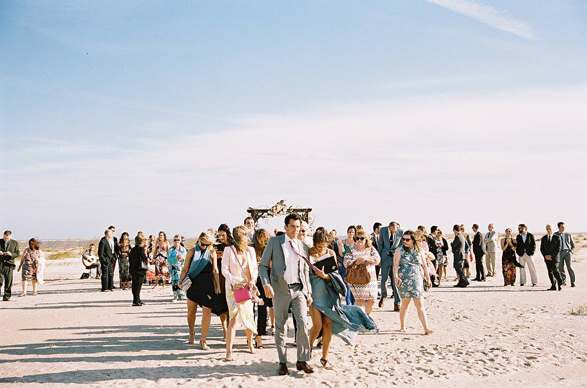 guests leaving beach ceremony
