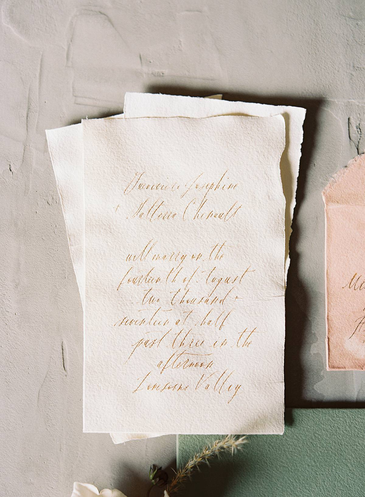 hand torn wedding stationery
