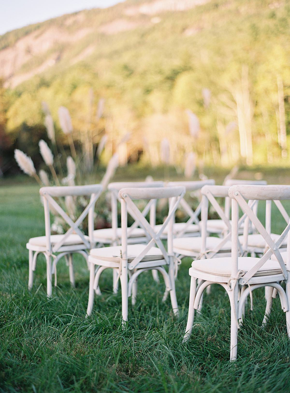 whitewashed ceremony chairs